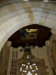 Bells hoisted through floor above baptistery, into bell chamber